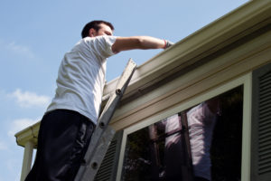 guy cleaning gutters
